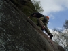 Paul committing to the run-out finish of Three pebble Slab E1 5a